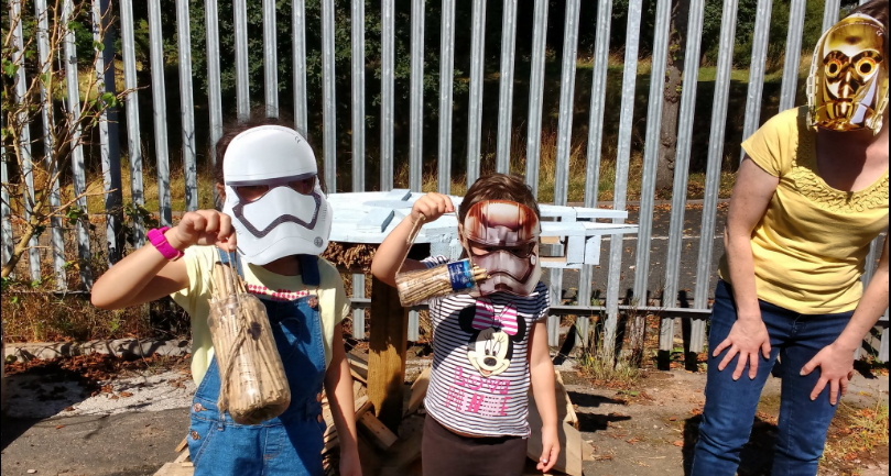 Young volunteers helping to build a star wars themed bug hotel