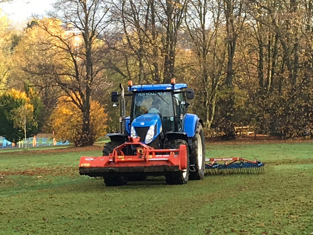 Tractor harrowing Manor Farm Park ready for some seed sowing